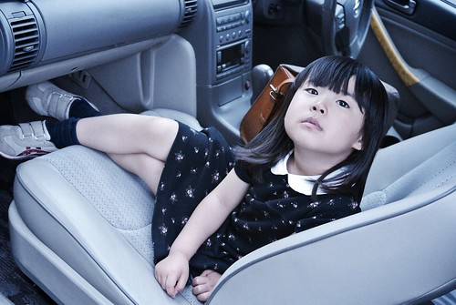 SAKURAKO rides in the front passenger seat of car.