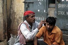 Cleaning Ears (ramesh_lalwani) Tags: 6 delhi streetshots chandnichowk