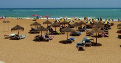 Lazing on the Beach (Snowdrop500) Tags: ocean sea summer sky holiday beach portugal water sand europe atlantic algarve atlanticocean sunbathing albufeira parasols sunlounger umberellas