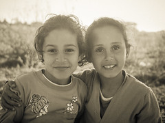 Neighborhood glows (aminefassi) Tags: africa street portrait people blackandwhite bw copyright black sepia children lumix kid child morocco maroc moroccan rabat  photographe marocain  marueccos temara 20mmf17 dmcgf3 aminefassi