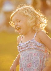 Happiness and Sunshine (Bill Gracey) Tags: california sunlight girl smile sunshine childhood laughing happy kid concert warm child bokeh joy warmth happiness highlights precious innocence littlegirl laughter highkey backlit backlighting sunflare santee