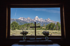A Look Out The Window (Dingus98) Tags: tetonnationalpark wyoming logcabinchurch oldchurch tetons window mountains treees cross railfence billbell