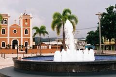 Church and fountain 2 (Enano Siniestro) Tags: plaza film church water fountain 35mm canon de lens puerto eos san catholic superia iso400 28mm rico pr fujifilm usm elan f18 sebastián xtra recreo martir 7n 2013