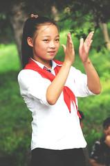 Young pioneer girl dancing in Moranbong Park, Pyongyang / DPRK (anji) Tags: northkorea dprk democraticpeoplesrepublicofkorea