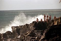 16-578 (ndpa / s. lundeen, archivist) Tags: ocean color film water 35mm hawaii coast rocks surf waves break oahu nick tan wave spray pacificocean northshore suntan honolulu 16 splash 1970s spectators 1973 waimeabay swimsuits tanned youngpeople breakingwave suntanned crashingwaves dewolf breakingwaves nickdewolf photographbynickdewolf sittingontherocks reel16