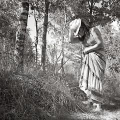 (helle-belle) Tags: summer portrait bw woman selfportrait me monochrome hat blackwhite warm dress sommer lookingdown birchtrees 2011 kjole selvportræt kvinde hellebelle birketræer canoneos5dmrkii 52wsp2011reject