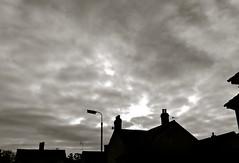 Dark skies (photowarrington) Tags: cameraphone street city cambridge blackandwhite bw cloud sun sunlight house apple monochrome silhouette mono moody iphone 2013 vision:mountain=0578 vision:outdoor=0692 vision:sky=0913 vision:clouds=0931