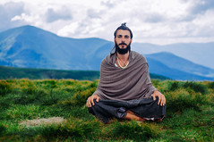 yogi meditating in mountains, Ukraine (Zhenya bakanovaAlex Grabchilev) Tags: portrait mountains men nature field beard landscape loneliness natural outdoor top indian young meadow lifestyle ukraine silence yogi lonely meditation eco carpathians