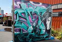 Hair Blowing in the Wind (Jocey K) Tags: newzealand christchurch people streetart colour art architecture buildings mall mural exhibition paining artbeat restartmall artbeatexhibition