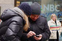 Checking on email, at Rockefeller Center - Dec 2013 (Ed Yourdon) Tags: christmas newyork manhattan cellphone rockefellercenter cap woolcap