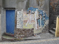 Cubish (Nekoglyph) Tags: street door blue urban white brick art public lines yellow wall concrete squares mosaic yorkshire steps tiles scarborough cobbles figures cubist blandscliff
