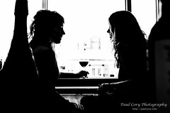 Wine Chat (Paul Cory) Tags: lighting camera people blackandwhite woman silhouette female lens clothing model afternoon dress unitedstates wine availablelight northcarolina naturallight raleigh event alcohol onlocation wakecounty postprocessing canoncamera sigmalens timeofday downtownraleigh hamptoninnandsuites niksoftware canon5dmkiii silverefexpro2 colorefexpro4 sigma2470f28hsmex susanroszkovanness rpgwinter2014shootout thewinefeed