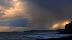Here comes the rain (KerKaya) Tags: leica blue light sea sky seascape storm water rain clouds sunrise landscape lumix waves purple cliffs panasonic kerkaya