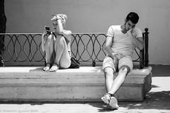 Separate lives (ralcains) Tags: bw espaa blancoynegro monochrome analog canon eos monocromo blackwhite sevilla analgica spain monochromatic seville andalucia analogue andalusia analogica eos1n qumica siviglia monocromtico andalousia streetphotograhy adox silvermax