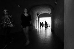 On the move (M a u r i c e) Tags: people blackandwhite monochrome walking prague wideangle tunnel efs1022mm ultrawidezoom
