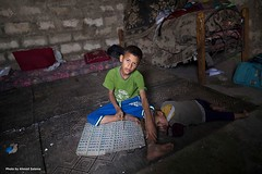 #child #sister #study #Multiplication_table  from Naher Al-Baried at north of Khan Younis (TeamPalestina) Tags: reflection heritage beautiful sunrise canon landscape hope landscapes photo am amazing nice nikon photographer natural sweet live palestine innocent comfort blockade ramadan freepalestine palestinian occupation