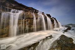 Waterfall at Karang Taraje (Shahrulnizam KS) Tags: travel blue cloud tourism water rock indonesia flow amazing nikon cloudy wave traveller sunda sundanese sawarna banten shahrulnizamks