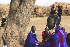 """She doesn't look to me"" - Maasai - Tanzania - Africa (TLMELO) Tags: africa friends boy portrait woman baby kilimanjaro hat mom tanzania kid women bravo child brothers retrato african poor son boring mount angry criança pobre tribe serengeti menino masai maasai tribo africana africano kilimanjaromount"