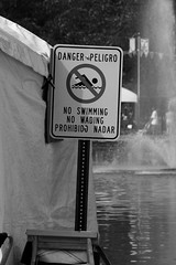 SO, BEFORE I COULD GET OUT MY SPANISH-ENGLISH DICTIONARY . . . (NC Cigany) Tags: bw signs water danger warning nc funny charlotte humor gray peligro