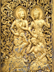 Door carvings at the Buddhist Temple (Evgeny Ermakov) Tags: door old travel decorations vacation art tourism beautiful beauty asian religious gold golden design la carved ancient asia southeastasia image antique buddha buddhist traditional religion decoration culture buddhism holy exotic ornament figure destination local southeast typical laos figures luangprabang luang touristic tracery phrabang luangphrabang buddhistic ornamentals louangphabang