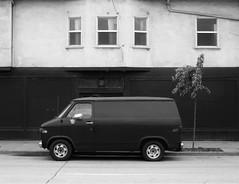 The Black Van (Bart D. Frescura) Tags: oakland oaklandcalifornia bw blackandwhite van lightandshadow lightanddark street driveby bayarea bartdfrescura