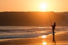Fishing at sunset . (Rafa Velazquez) Tags: sunset silhouette fishing cadiz bolonia tarifa