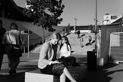 Sunny at last (KevPBur) Tags: people blackandwhite bench reading sitting steps streetphotography sunny berkshire readingstation sigma30mmf14exdchsm canon650d canonrebelt4i canonkissx6i canon650dcanonkissx6icanonrebelt4i