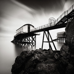 Launches (Andy Brown (mrbuk1)) Tags: ocean longexposure seascape monochrome rock wales fence square blackwhite fineart steps shoreline framing pembrokeshire tenby stilts rnli holidayhome granddesigns neutraldensity lifeboatstations