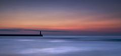 Any Colour you Like (Elidor.) Tags: sea sky lighthouse silhouette sunrise dawn coast pier horizon northumberland northeast berwickupontweed darksideofthemoon spittal d90 silverrainbow