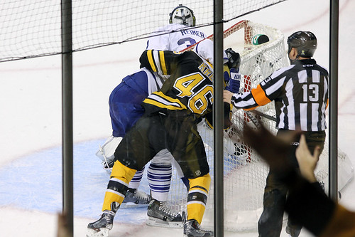 David Krejci is grabbed by Carl Gunnarsson