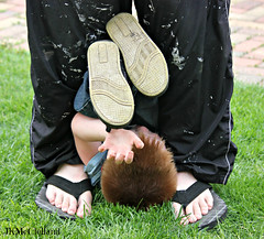 Stuck (ThroughMyEyes_JKM) Tags: people playing feet boys kids outside spring shoes hand stuck legs