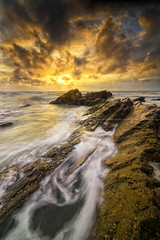 Burning Clouds (MunzerShamsul) Tags: morning sun seascape travelling nature rock clouds sunrise landscape nikon waves shorelines filter malaysia slowshutter terengganu eastcoast d800 rockformation waterscapes goldenclouds leefilter tanjungjara nikonmalaysia tokina1116mm munzershamsul