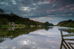 Mire Loch. (Jonathan Combe (Thank you for 400,000 views!)) Tags: wood trees sunset sky green clouds forest fence reflections scotland landscapes day cloudy loch boathouse stabbs nikon1855mm mireloch leefilters nikond7000 lee06hardgrad
