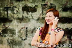 Gossip girl (Gilbert Rondilla) Tags: city family urban woman smile smiling female asian happy healthy phone vibrant philippines capital smiles cellphone happiness listening national manila getty filipino pinay filipina jolly gadget talking joyful tablet region connectivity connection pinoy gettyimages gossip asianethnicity valenzuelacity gettyimagescollection