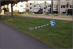Mr Stick is taking a break in the green grass. (karlstad Igr) Tags: karlstad roadsign canonef2470mmf28l mrstick fenan canoneos6d