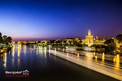 Torre del Oro, Sevilla. (Marqus!) Tags: old city travel bridge sunset holiday building tower heritage tourism monument beautiful architecture night del river landscape boats gold lights golden town sevilla spain ancient guadalquivir europe european cityscape torre exterior view symbol famous sightseeing landmark tourist seville andalucia historic spanish moorish destination aged andalusia andalusian oro triana sevillan mozarabic