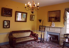 Dow House Parlor ~ 1839 (PelicanPete) Tags: history glass overgrown yellow fence landscape quiet unitedstates florida 19thcentury statues peaceful curtains johnhenry lush quaint frontporch roomwithaview parlor tranquil 1839 talltrees floridahistory saintaugustine ushistory windowofopportunity 19thcenturyglass windowoftime ninehouses windowonthepast dowhouse onesquareblock dowmuseumofhistorichouses builtbetween1790to1910 kennethworcesterdow