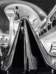 Ion Orchard (streettog) Tags: people bw lines geometry candid escalator orchard ion iphone uploaded:by=flickrmobile flickriosapp:filter=nofilter