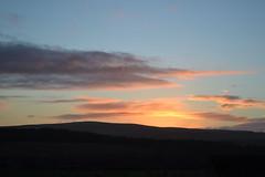 Sunday morning walk (Beachcombing Bumpkin) Tags: uk pink blue trees sky orange mountains rural sunrise scotland countryside purple farm hills fields silhoette