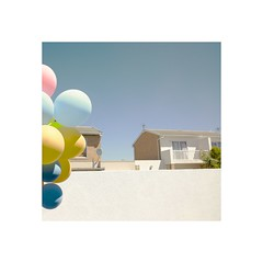 Balloons, walls, sky and tree. (crabsticky1) Tags: blue party summer sky house home wall garden balloons children landscape outside graphic pastel balloon suburbia minimal borderfx