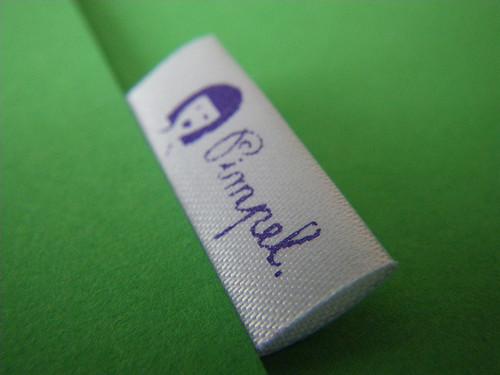 25mm wit lint met paars bedrukt in eigen