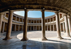 A columned courtyard at the Palace of Charles V (Palacio de Carlos V), site of the Museum of the Alhambra in Granada, Spain. (Fotografiecor.nl) Tags: old city travel building castle heritage history classic tourism monument beautiful beauty stone wall architecture digital court circle square photography design spain construction ancient europe king foto fotografie view angle photos antique famous stock pillar arcade columns wide decoration culture royal charles carlos nobody landmark courtyard palace images tourist andalucia historic unesco arabic spanish ornament alhambra granada round download historical andalusia fortress renaissance circular attraction colonnade andalusian palacio fotograaf carlosv charlesv southernspain fotocor fotografiecor fotografiecornl