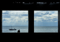 The Indian Ocean Seen Thru A Window, Island Of Mozambique, Mozambique (Eric Lafforgue Photography) Tags: africa sea people color window water horizontal outdoors photography boat solitude day waterfront indianocean unesco indoors transportation mast oneperson mozambique dhow worldheritage moambique eastafrica menonly ilhademoambique fulllenght onemanonly colourimage 1people portuguesecolony horizonoverwater nampulaprovince nauticalvessel islandofmozambique provincedenampula moz692