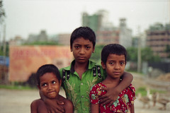 The Reluctant, The Serious and The Poser (Sheikh Shahriar Ahmed) Tags: street boy film girl kids analog children kid child streetlife fujifilm nikonf6 childportrait af50mmf18d fujicolorc200 aftabnagar epsonv330 sheikhshahriarahmed