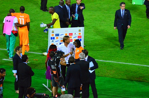 Gervinho and Ivory Coast coach Herve Renard doing TV interviews on the pitch after winning the 2015 African Nations Cup final