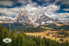 Spring at Alpe di Suisi (jkuphotos) Tags: trees sky italy snow mountains alps nature clouds landscape outdoors scenery meadow snowcapped range dolomites dolomiti southtyrol seiseralm alpedisuisi