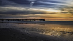 Slow Venice Glow (Wilkof Photography) Tags: ocean california ca longexposure venice winter light sunset shadow sea sky seascape reflection geometric beach nature wet water beautiful silhouette skyline architecture canon lens landscape outside golden coast pier countryside daylight losangeles seaside sand rocks colorful skies afternoon waterfront sundown cloudy horizon rustic perspective scenic windy overcast panoramic symmetry pacificocean socal le nd land coastline venicebeach february southerncalifornia hazy polarizer cloudcover beachfront goldenhour cpl 18mm oceanfront oceanscape neutraldensity 18135mm 10stop nd1000 venicebeachpier canont4i wilkofphotography