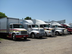Row of Trucks (TrueWolverine87) Tags: truck parkinglot lot semi trailer semitruck tractortrailer hauler