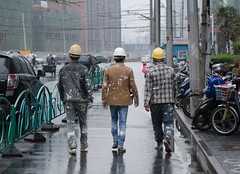 Lunch Break (pruse) Tags: china road street city urban 3 reflection rain three construction shanghai walk helmet worker hongkou