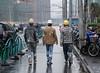 Lunch Break (pəruse) Tags: china road street city urban 3 reflection rain three construction shanghai walk helmet worker hongkou